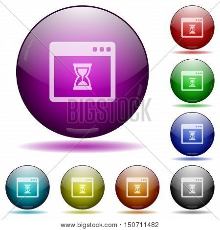 Set of color application wait glass sphere buttons with shadows.