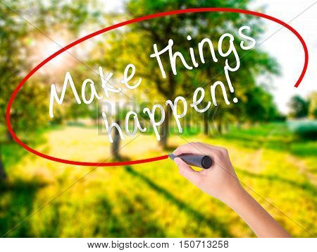 Woman Hand Writing Make Things Happen With Marker On Transparent Wipe Board