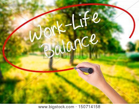 Woman Hand Writing Work-life Balance With A Marker Over Transparent Board