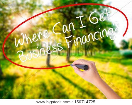 Woman Hand Writing Where Can I Get Business Financing? With A Marker Over Transparent Board .