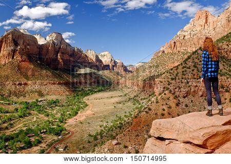 Woman Hiker Overlooking Zion Canyon.  Zion National Park, Utah.