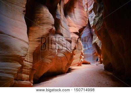 Female Hiker In Colorful Slot Canyon.  Antelope Canyon, Grand Staircase Escalante National Monument, Utah