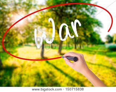 Woman Hand Writing War With A Marker Over Transparent Board
