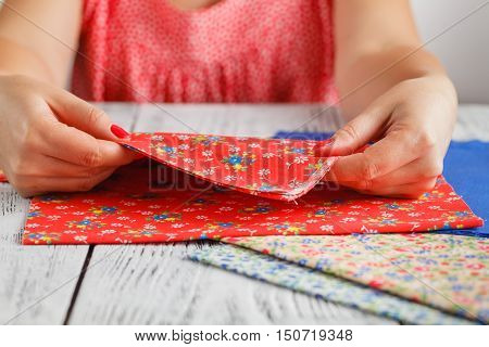 Needlework concept. Female doing crafts on table poster
