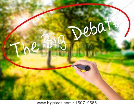 Woman Hand Writing The Big Debate With A Marker Over Transparent Board