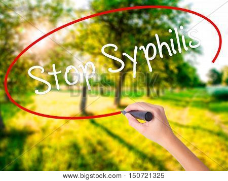 Woman Hand Writing Stop Syphilis With A Marker Over Transparent Board