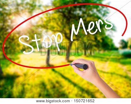 Woman Hand Writing Stop Mers With A Marker Over Transparent Board