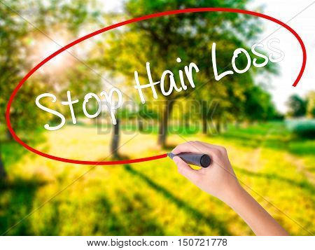 Woman Hand Writing Stop Hair Loss  With A Marker Over Transparent Board