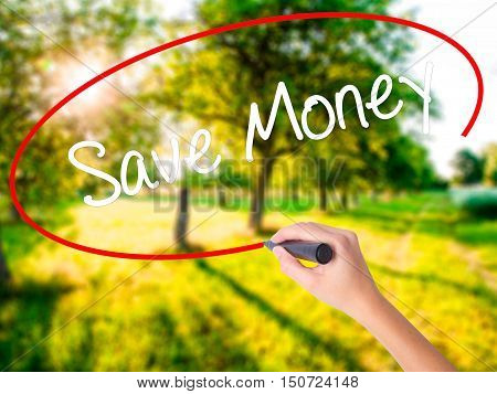 Woman Hand Writing Save Money With A Marker Over Transparent Board