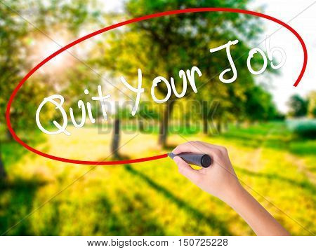 Woman Hand Writing Quit Your Job With A Marker Over Transparent Board .