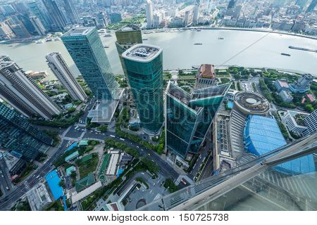 SHANGHAI - AUG 13, 2015: Top view of skyscrapers and river quay, view from IFC hotel, 990 skyscrapers are in Shanghai