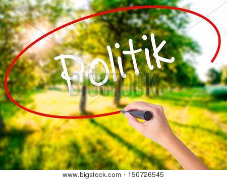 Woman Hand Writing Politik (politics In German) With A Marker Over Transparent Board