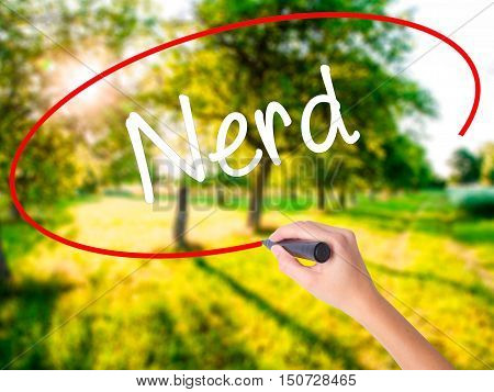 Woman Hand Writing Nerd With A Marker Over Transparent Board