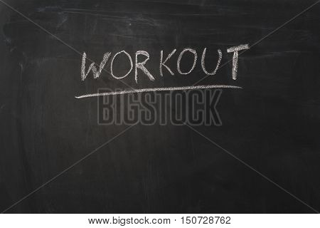 Workout concept image. Empty background with workout text and lots of copy space. Horizontal photograph.