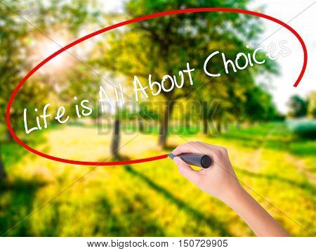 Woman Hand Writing Life Is All About Choices With A Marker Over Transparent Board