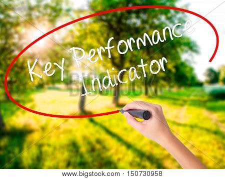 Woman Hand Writing Key Performance Indicator With A Marker Over Transparent Board .
