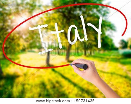 Woman Hand Writing Italy With A Marker Over Transparent Board .