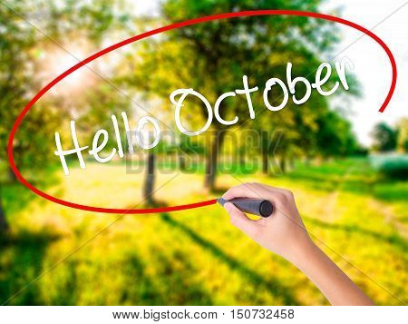 Woman Hand Writing  Hello October  With A Marker Over Transparent Board