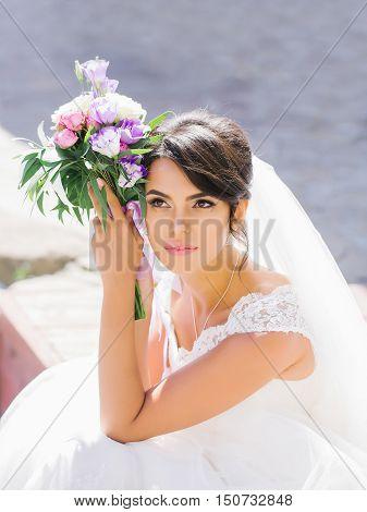 Pretty Bride With Flower Bouquet