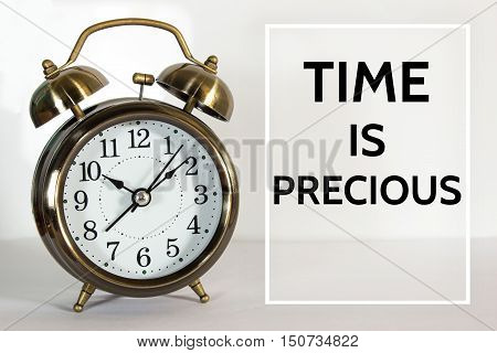Text Time is precious on clock background / time concept