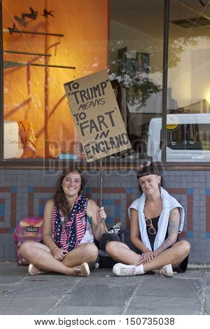 Asheville North Carolina USA: September 12 2016: Two young women hold a sign at a Donald Trump campaign rally saying