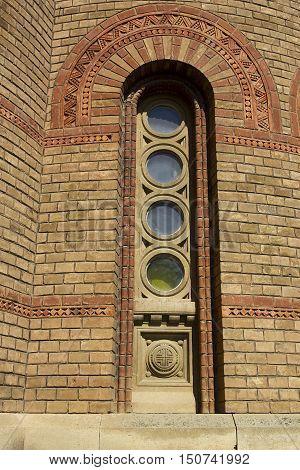 Window in retro masonry brick stone building house wall.