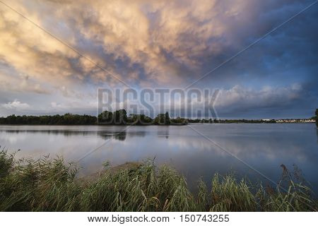Stunning Dramatic Mammatus Clouds Formation Over Lake Landscape Immediately Prior To Violent Storm
