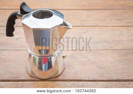 Metal coffee maker on wooden table stock photo