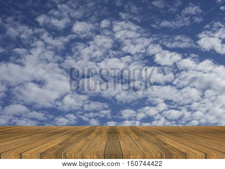 Empty top wooden table and bluesky and clouds in background,Can use for product display