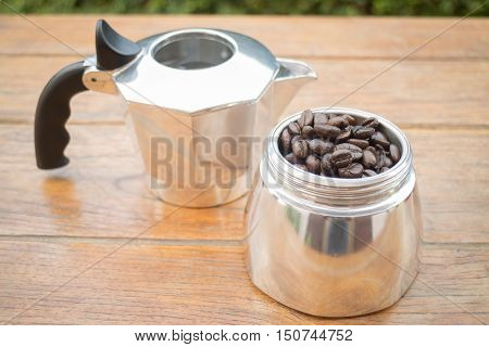 Roasted coffee beans in moka pot stock photo