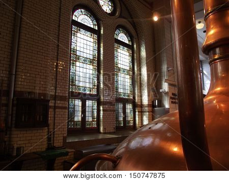Perspective view of an old distillery with stained glass windows