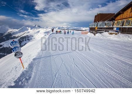 Kitzbuehel, Austria - February 17, 2016 - Skiers Skiing In Kitzbuehel Ski Resort And Enjoying Alps V