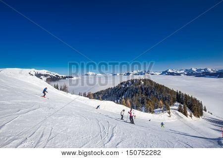 Kitzbuehel, Austria - February 18, 2016 - Skier Skiing And Enjoying The View To Alpine Mountains In