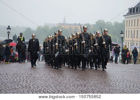 STOCKHOLM, SWEDEN - AUGUST 29, 2016: A detachment of the Royal guards marching on the square near the Royal Palace. Historical landmark of the city Stockholm