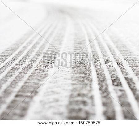 Wheel tracks on the winter road covered with snow.