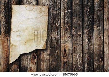 vintage paper on old wood texture
