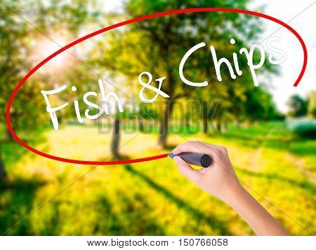 Woman Hand Writing Fish & Chips With A Marker Over Transparent Board