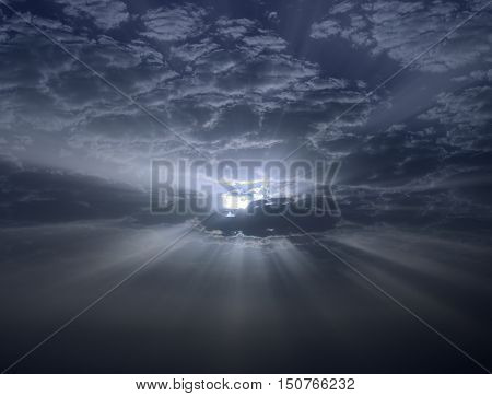 Amazing dawn with sunrays through the clouds