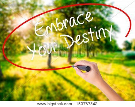 Woman Hand Writing Embrace Your Destiny With A Marker Over Transparent Board .