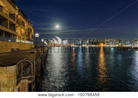 Sydney opera house night view with full moon in Sydney,Australia.Oct 08,2016 Sydney Opera House is famous arts center. Over 10 millions tourists visit Sydney a year.