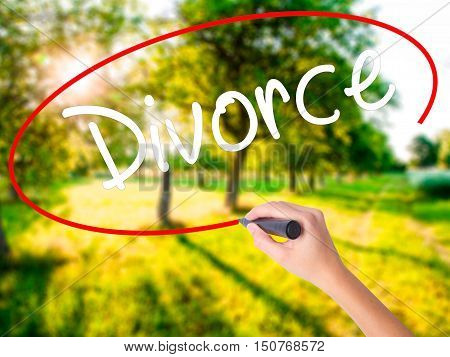 Woman Hand Writing Divorce  With A Marker Over Transparent Board