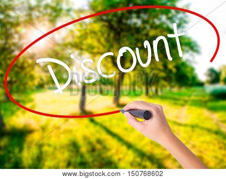 Woman Hand Writing Discount With A Marker Over Transparent Board
