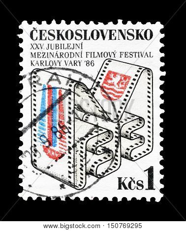 CZECHOSLOVAKIA - CIRCA 1986 : Cancelled postage stamp printed by Czechoslovakia, that shows Karlovy Vary film festival emblem.
