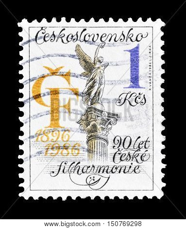 CZECHOSLOVAKIA - CIRCA 1986 : Cancelled postage stamp printed by Czechoslovakia, that shows Philharmonic orchestra 90th anniversary.