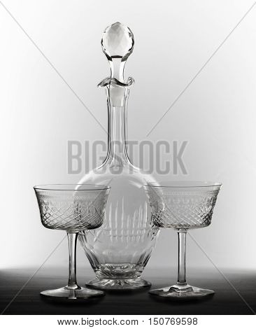Two transparent glasses and decanter with a cork