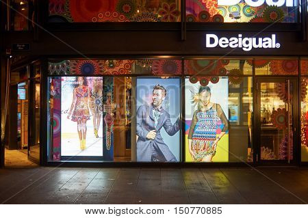 GENEVA, SWITZERLAND - NOVEMBER 18, 2015: a Desigual store at night. Desigual is a clothing brand headquartered in Barcelona, Spain.