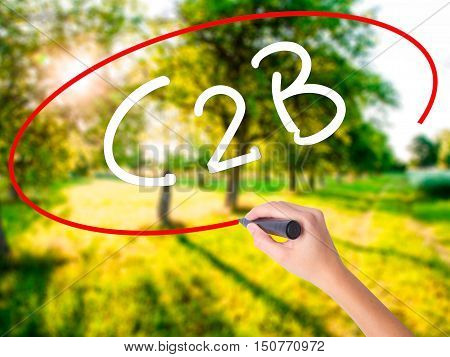 Woman Hand Writing C2B With A Marker Over Transparent Board