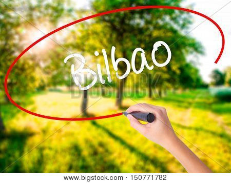 Woman Hand Writing Bilbao  With A Marker Over Transparent Board