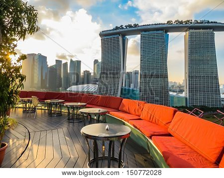 SINGAPORE, REPUBLIC OF SINGAPORE - JANUARY 09, 2014: View of Marina Bay Sands Hotel from Supertree's rooftop - SuperTree by IndoChine alfresco rooftop bar. Supertree Grove, Singapore