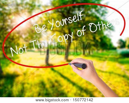 Woman Hand Writing Be Yourself Not The Copy Of Others With A Marker Over Transparent Board